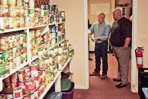 President of HELP of Beaufort Steve Curless and Mike Covert of Covert Aire look at the cans of food at HELP on Tuesday, Dec. 31