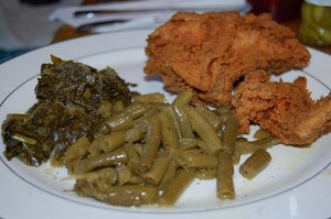 Fried chicken with green beans and collard greens.