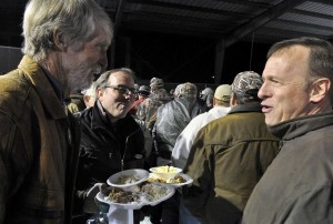 Dr. Carl Broggi, right, senior pastor of Community Bible Church, greets and chats with some of the men participating in the church's Men's Wildlife Supper last week.