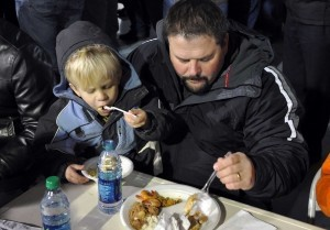 David Zeoli and his son David, Jr. eat some of the 360 pounds of shrimp served at the Men's Wildlife Supper.