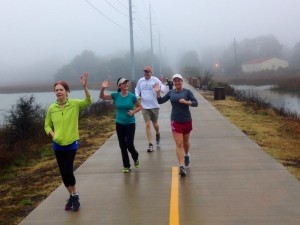 From left: Nancy Coldiron, Maggie Mitchell, Tim Roddey and Megan Taylor run on the Spanish Moss trail.