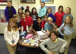 The students in Mrs. Lindsay's fifth grade history class at Beaufort Academy recently responded to a request from Delany Retko, a fifth grade student at Cascade Christian Schools in Washington state, asking students in Beaufort County for information and items about South Carolina for a school project. The students each wrote a letter and sent in several objects that represented the Lowcountry as well as our state. The class was proud to share information about  their hometown with someone almost 3,000 miles away. Among the many creative items sent were T-shirts, pamphlets, bumper stickers, hand-written journals and shark's teeth!