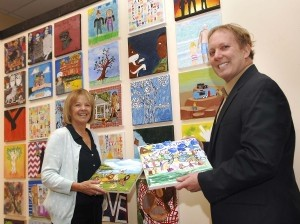 Jane Abrams and John Williams display art to be auctioned at the Artscapade fundraiser for the Northern Beaufort County Public Education Foundation. The event will be held Thursday, Feb. 20, 6 to 8:30 p.m. at ARTworks Gallery in Beaufort Town Center. Tickets are $20 per person; proceeds go toward grants for public and charter school teachers in northern Beaufort County. For more information, visit www.beaufortteacherfund.com. Photo by Bob Sofaly.