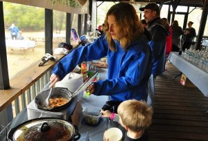 Leta Matte dips out some of her chili for her son last Saturday during the Chili Cookoff.