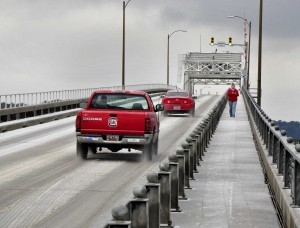 Traffic makes its way over the Richard V. Woods Bridge as a pedestrian makes her way down the path last Wednesday.