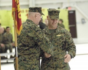 Outgoing commanding officer, Col. Brian C. Murtha, left, congratulates Col. Peter D. Buck, right, as the new commanding officer of Marine Corps Air Station Beaufort during the Change of Command Ceremony Thursday, Feb. 13.
