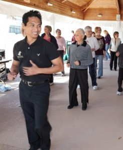 """Armando Aseneta, owner of the Fred Astaire Dance Studio, leads a class at last year's event. """"The great thing about dancing is that you don't even realize you're exercising,"""" he said."""