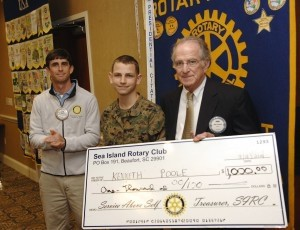 John Perrill, right, of the Sea Island Rotary Club, presents Kenneth Poole with a check for $1,000 on Tuesday, March 18, during the club's weekly meeting. At left is club president Rion Salley. Poole, 16, a Battery Creek High School sophomore, is recovering from bone cancer and is also in the school's JROTC and INTERACT club. He is raising money to become a People to People Student Ambassador to Australia this summer. Photo by Bob Sofaly.