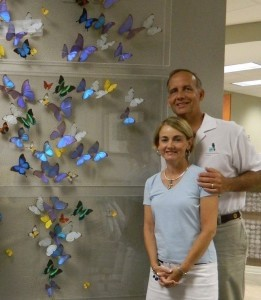 Steve and Vicki Mix are seen with the butterfly display they donated to Beaufort Memorial Hospital.
