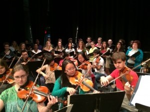 The chorus and orchestra rehearse.