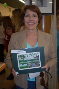 Sandra Papp won a print of an original acrylic painting donated by Lynette, owner of Brick Houses.