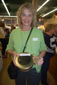 Shirley Martin holds her tin of delicious Benne Wafers from Low Country Sweets.