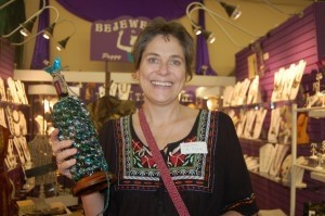 Martha O'Regan laughs as she holds the wine bottle lamp she won because it is an item she has wanted since Christmas.