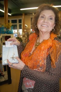 Kathy Welborn shows off her starfish necklace and earrings by BeJeweled.