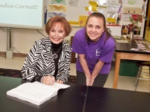 Author Dr. Claudia Cornett signs a book for dance teacher Lisa Ten Eyck. By Eric Smith of Captured Moments Photography.