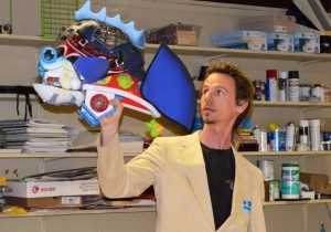 Terry Brennan gives a presentation on how to create art from recycled materials.