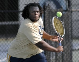 Battery Creek's No. 2 singles player Jonathan Wright returns a backhand to Beaufort Academy's Cain Richards.