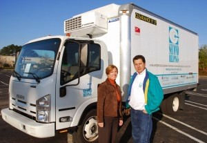 Second Helpings Executive Director Maureen Korzik stands with Beaufort Coordinator Cesar Garcia in front of one their delivery trucks.