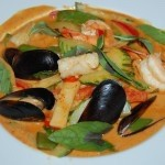 Red curry with mussels, calamari and shrimp.