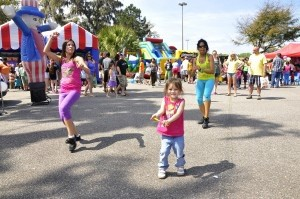 Cascity Costanzo, 4, center, tries her best to keep up with the fast-paced dancers during the Zumba exhibition at KidFest.