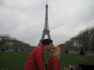 """Rick and Deborah Stone in Paris where they go for food inspiration. They are in their pajamas in front of the Eiffel Tower on Christmas morning. Rick said, """"We love to travel and our favorite place in the world is Paris where I simply let Deborah, who is fluent in French, do the talking and I just nod and follow along. My one attempt at ordering in French I ordered a battleship of wine rather than a bottle. I have been silent in that language ever since."""""""