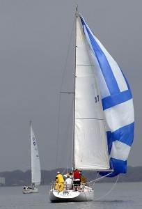 """Sailboat """"LOKI,"""" owned by Ricky Akers, gets her spinnaker up as she maneuvers in the less than optimal wind during the Jean Ribaut Cup on Saturday, March 28 in the Beaufort River, near Parris Island. Photo by Bob Sofaly."""