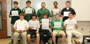 """Nine Beaufort High students who have been taking Joseph Tokar's """"Computer Service Tech 2"""" class have received national certification that can take them directly from school to work. These students took the TestOut PC Pro Certification, enabling them to analyze and fix problems on PC hardware and software and understand Windows operating system management.  Steven Bancroft reached the maximum score of 1500. Back row, from left: Max Hill, Tyler Rentz, Joseph Tokar (Instructor), Jordan Washington, Alex Tokar. Front row, from left: Christian Hart, Allen Harm, Steven Bancroft, Charles Bootle, Joseph Dilsaver. Not pictured: Daniel Singletary."""