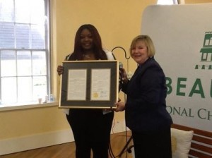 Representative Shannon Erickson presented a special South Carolina House resolution to Candice Glover in Beaufort.