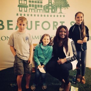 """American Idol winner and St. Helena Island native Candice Glover (second from right) was in Beaufort last weekend to sign copies of her debut album """"Music Speaks."""" Here she poses with siblings (from left) Sam, Lissy and Molly Rembold."""