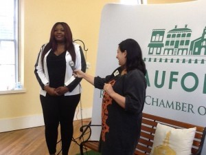 Beaufort Regional Chamber of Commerce CEO Blakely Williams turns the mic over to American Idol winner Candice Glover.