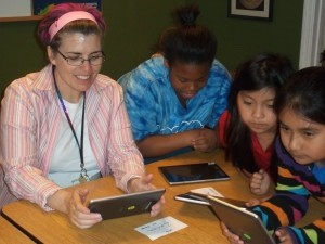 Educators teach elementary and middle school children how to use hand-held computer tablets to improve reading skills during the after school program at the Thumbs Up Children's Learning Center in Beaufort.