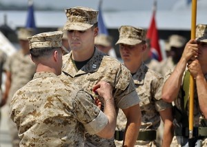 Lt. Col. Joshua Riggs, left, commanding officer of Marine Fighter Attack Squadron 251, pins the Bronze Star to the uniform of Capt. William Paxton on Monday, May 5 at Marine Corps Air Station Beaufort.