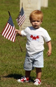 Jack Kayler does his part in helping put out American flag last Thursday at Beaufort National Cemetery,