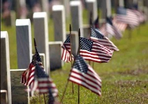 Some of the many American flags that mark each grave at Beaufort National Cemetery.