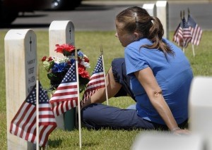 Cindy Baxter took a few minutes to visit with her husband Gunnery Sgt. Kenneth Baxter on Friday, May 23, at Beaufort National Cemetery. Baxter said her husband died two years ago this month but it feels like it was just yesterday.