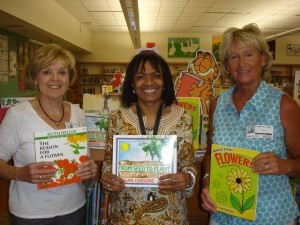 On April 24, the Dataw Island Garden Club, with the assistance of Adopt-a-School, donated over $500 of books to St. Helena Elementary School. Through fundraising, the Garden Club raises money for area youth. This year their focus was on St. Helena Elementary School. Pictured above, from left: Peg Dale, Youth Committee Co-Chair; Deborah Martin, Media Specialist at St. Helena Elementary School; and Chris Dedal, Youth Committee Co-Chair.