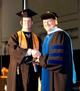 TCL Student of the Year Jonathan Bryant, left, is congratulated by TCL President Dr. Richard Gough at TCL's 2014 Commencement Ceremony.