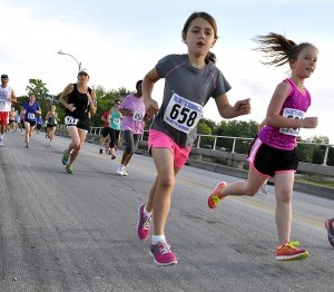 It was full speed ahead as runners of all ages braved the Richard V. Woods Memorial Bridge during A Taste of Beaufort 5K last Saturday morning. Photo by Bob Sofaly.