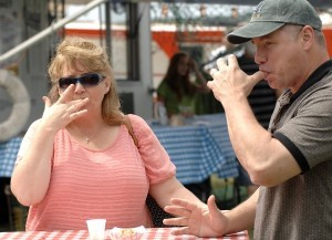 """Debbie and Greg Smith of Lexington, SC, prove that food served up during A Taste of Beaufort was """"finger lickin' good."""" Photo by Bob Sofaly."""