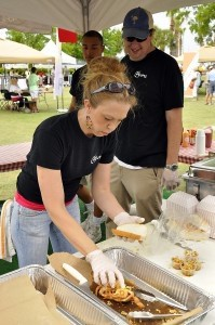 Jennifer Mader of Plums makes a fried soft-shell crab sandwich during the annual Taste of Beaufort last Saturday. Looking on is Chip Dinkins, also of Plums. Photo by Bob Sofaly.