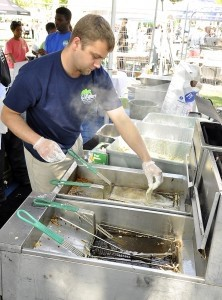 John Hartz of Gilligans, drops battered flounder into the hot oil during the 15th annual A Taste of Beaufort event last Saturday at the Waterfront Park. Photo by Bob Sofaly.