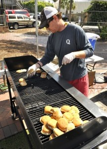 Jason Bailey of Q on Bay, toasts buns for making slider sandwiches during the annual Taste of Beaufort last Saturday at Henry C. Chambers Waterfront Park. Photo by Bob Sofaly.