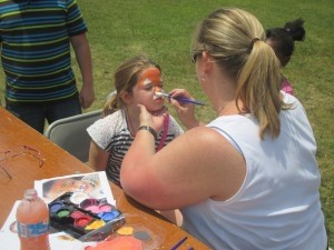 Lady's Island Middle School recently held a Spring Carnival.  There were games and activates, food and lots of prizes. Art teacher Ms. Rooney is seen above painting the face of a young participant.