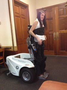 Kelli Bright demonstrates the Paramobile machine — which allows those who cannot walk to stand, play golf and get around in difficult places — before the Exchange Club. Photo courtesy of Ellier Gervero.