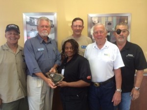 Commander Chris Swan and officers of the Disabled American Veterans present a plaque to store manager Judy Lawton at Hardee's for their outstanding ability to assist the DAV with their claims service each Thursday morning.  This award was presented at the State Department Convention in Columbia, SC.