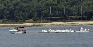 Because of the lack of wind and an incoming tide, a power boat was used to tow these sailors to the starting point of their race in the Port Royal Sound on Saturday. By race time the wind had kicked up enough for the sailors to race. Photos by Bob Sofaly.
