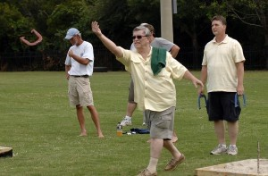 Lee Stokes, center, lets his shores shoe fly during the annual Beaufort Water Festival horseshoe tournament. Stokes teamed up with Michael Killeen.