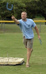 Donnie Daughtey uses a little body language during his follow through while pitching horse shoes in the annual Beaufort Water Festival tournament.