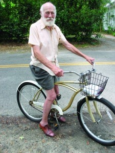 Nathan Harris, 84, is often seen in one of his dapper outfits riding his bike around town.
