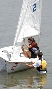Shelby Mixson and Chris Spears prepare their boat for the annual regatta on Saturday at the Beaufort Yacht and Sailing Club.